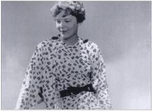 Amelia Earhart in a dress from her Amelia Earhart Fashion line in 1934.