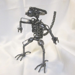 It's a reclaimed metal sculpture of the xenomorph from Aliens, John's favorite movie series.