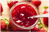 Homemade Organic Red Strawberry Jelly against a background